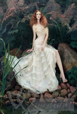 Fashionable wedding dress against a background of spring images