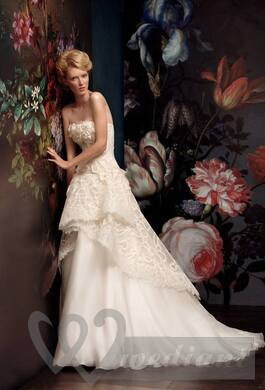 Stylish wedding dress against a background of spring images