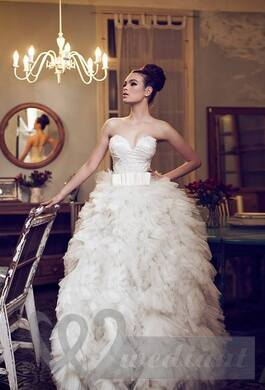 The wedding dress with the fluffy skirt