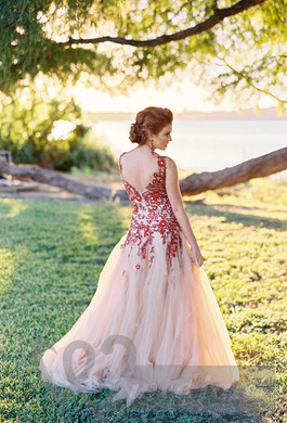 Pink wedding dress with red patterns