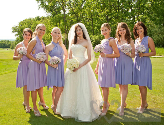 Bride and bridesmaids in lilac cocktail dresses