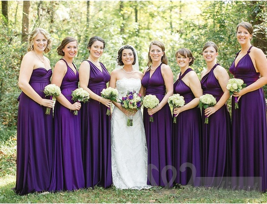 Bride and bridesmaids in violet evening dresses