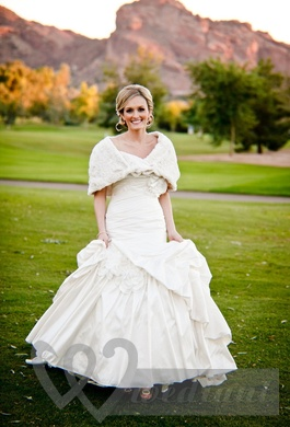 Warmed wedding dress with a cape