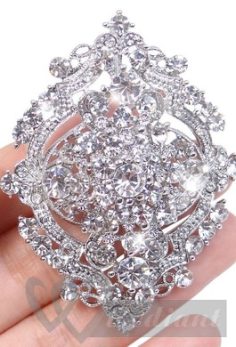 Bright light colored brooch